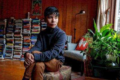 Ocean Vuong, a poet who teaches at UMass Amherst, sits for a portrait Nov. 14, 2017 in his Florence home.