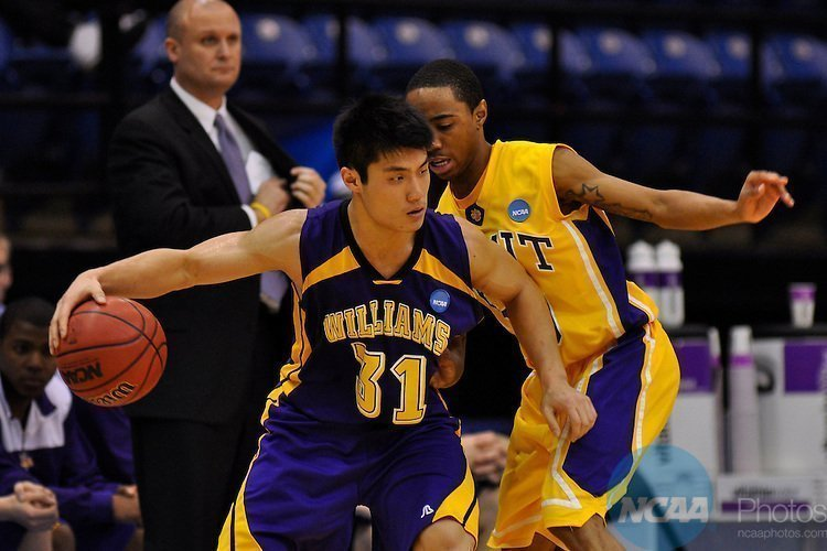 20 MAR 2010:  Guard James Wang (31) of Williams College attempts to drive past freshman Guard Jerrel Harris (10) of Wisconsin-Stevens Point during the Division III MenÕs Basketball Championship held at the Salem Civic Center in Salem, VA.  Wisconsin-Stevens Point defeated Williams 78-73 to win the national title.  Andres Alonso/NCAA Photos