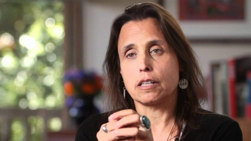 "LaDuke discussed two possible worldwide economic models of climate change, the ""scorched"" path of pollution and the ""green"" path of environmentalism. Photo courtesy of Youtube."