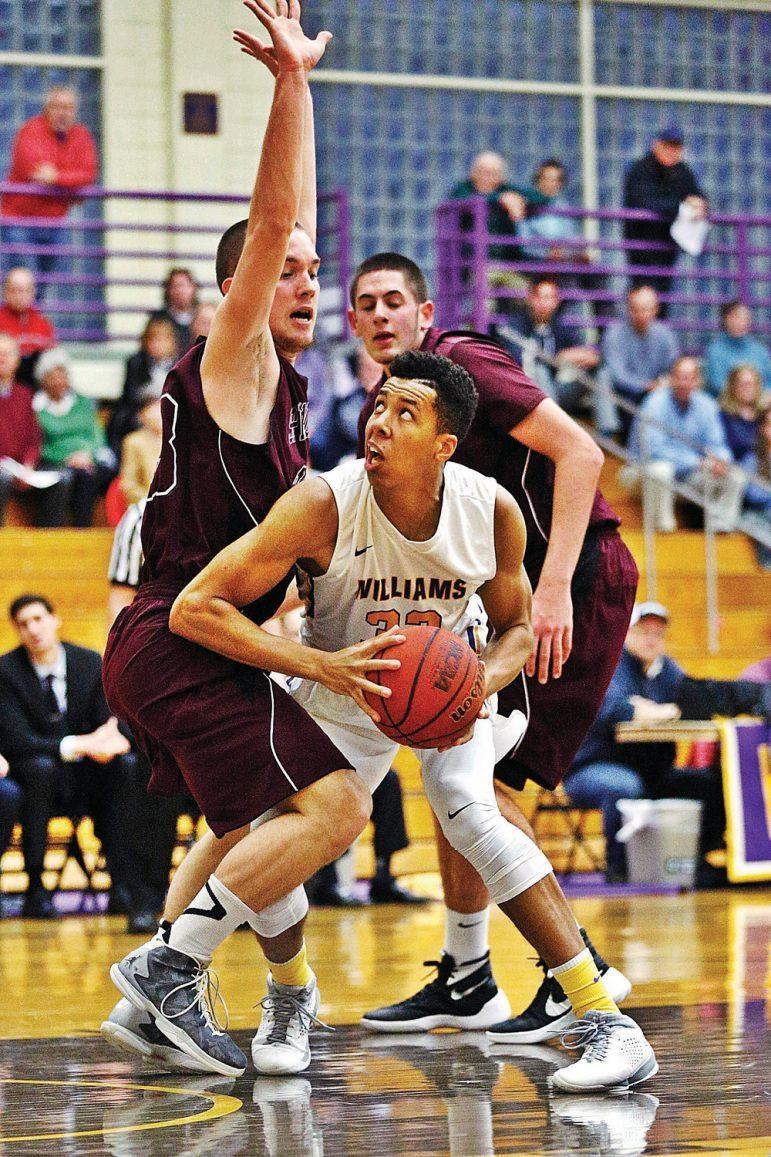 Williams' Kyle Scadlock looks up to the basket in a basketball game against Springfield College in a home game at Williams College in Williamstown. Saturday, December 12, 2015. Stephanie Zollshan — The Berkshire Eagle.