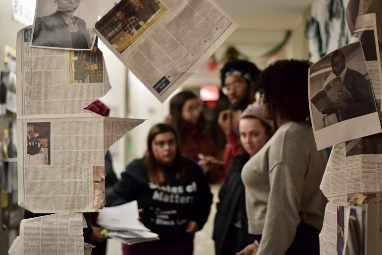 Students rebuild the memorial in Hollander Hall after the original one was deconstructed by a faculty member. SABRINE BRISMEUR/PHOTO EDITOR