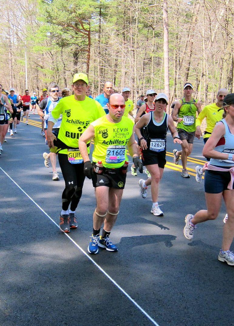 Art, left, guided Kevin Counihan in the Boston Marathon in 2011. Photo courtesy of Wikimedia Commons.