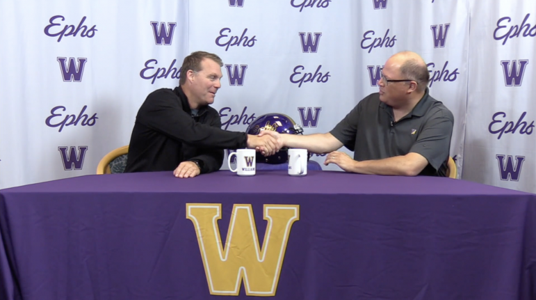 Kris Dufour (right), who has hosted the Williams College Football Show for 15 years, welcomes head coach Mark Raymond to discuss game highlights. Photo courtesy of WilliNet