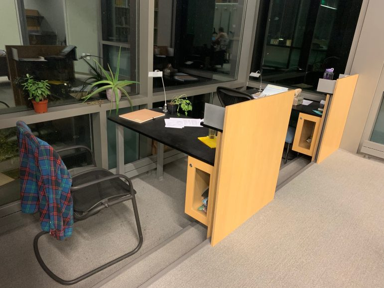 After camping out overnight,  seniors make carrels their own