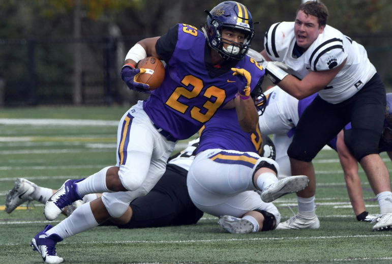 Running back Joel Nicholas '23 scored two touchdowns in Saturday's game against Bowdoin, rushing for a total of 104 yards. (Photo Courtesy of Sports Information.)