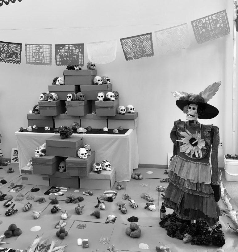 Students, visiting artist construct Day of the Dead altar