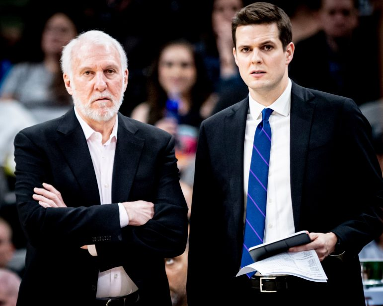 Will Hardy '10 (right) works as assistant coach of the San Antonio Spurs and the video coordinator for the USA Basketball Men's National Team alongside Gregg Popovich (left), head coach of the San Antonio Spurs and the USA national team. (Photo courtesy of Reginald Thomas II.)