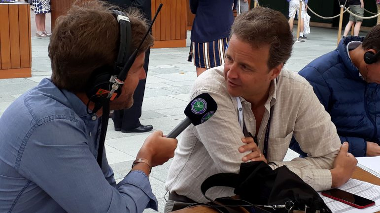 Christopher Clarey '86 talks to a colleague from the Wimbledon Radio Show during last year's tournament. (Photo courtesy of Christopher Clarey.)