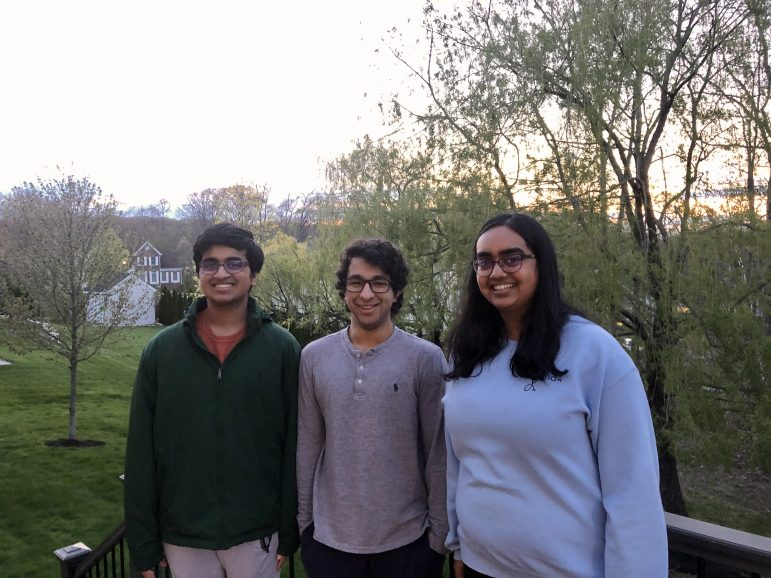 Shreyas Rajesh '22, an international student from India, poses with Nandini Seetharaman '22 and her brother at their home in Massachusetts. Rajesh decided to stay with Seetharaman and her family after the Indian border closed. (Photo courtesy of Shreyas Rajesh.)