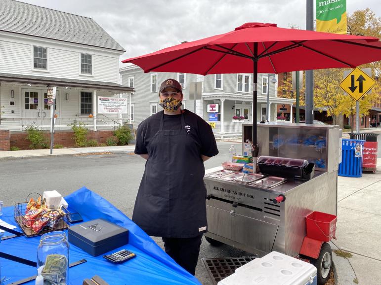 Staff members start Spring Street hot dog stand