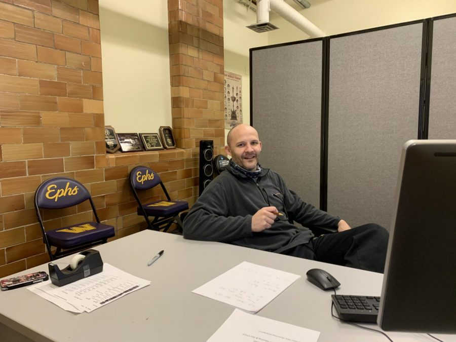 Despite not being able to see his athletes in person, men's wrestling coach Scott Honecker continues coaching and recruiting from his office with the help of technology. (Photo courtesy of Scott Honecker.)