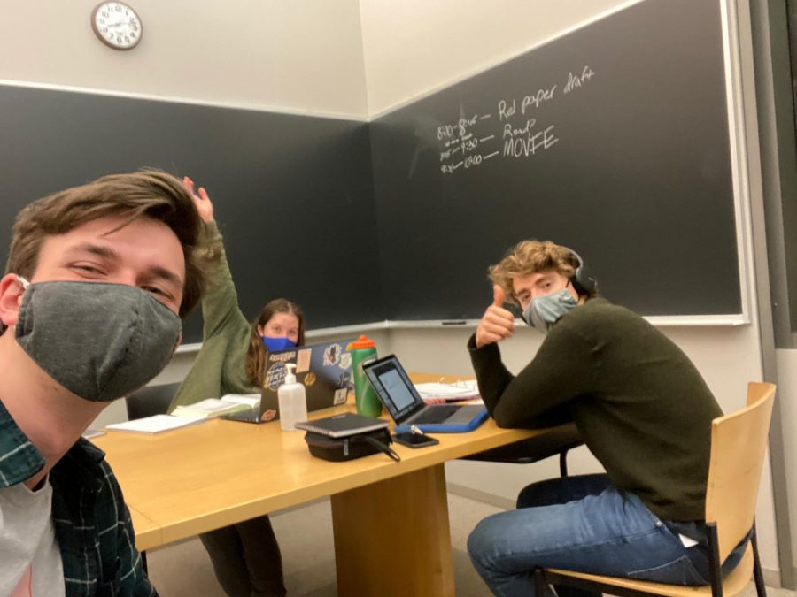 Peter Miles '24 (right) spends time with friends Andrew Nachamkin '24 (left) and Frances Hayward '24 (back) during a late-night study session. (Photo courtesy of Peter Miles.)