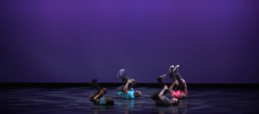 Raphael Xavier (in the middle) breakdancing on stage in 2017 at the Autorino Center for the Arts. (Photo Courtesy of Raphael Xavier.)