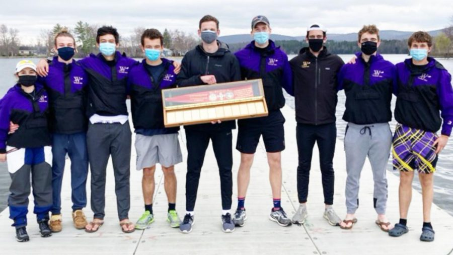 The men's crew 1v poses with the Saratoga Oar. (Photo courtesy of Sports Information.)