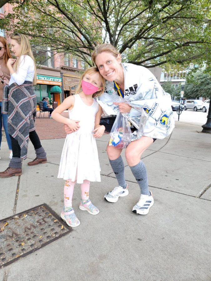 After running her fourth Boston Marathon, Jessica Chapman poses for a picture with her daughter, Mia. (Photo courtesy of Jessica Chapman.)